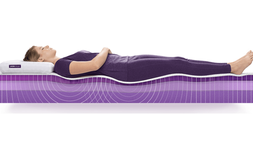 woman lying on a purple mattress