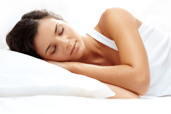 woman sleeping on a sleep apnea pillow