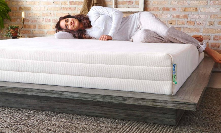 woman lying comfortably on her sleep on latex mattress